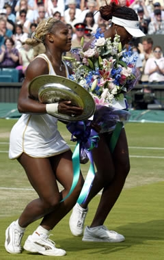Serena and Venus Williams curtsying on Wimbledon's Center Court, after Ladies Final